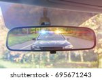view on rear mirror of a car.... | Shutterstock . vector #695671243
