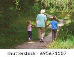 grandmother with kids walk in... | Shutterstock . vector #695671507
