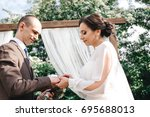 wedding day. the groom places... | Shutterstock . vector #695688013