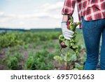 cropped shot of farmer holding... | Shutterstock . vector #695701663