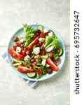 healthy salad with feta cheese... | Shutterstock . vector #695732647