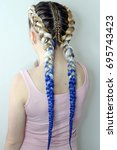 Small photo of Girl with two braids blue and white ambergris, fashionable youth
