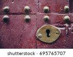old lock in a garnet door.   Shutterstock . vector #695765707