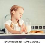 child looks with disgust for... | Shutterstock . vector #695780467