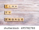 Small photo of time to engage text on cubes on wooden background