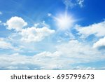 sun and clouds in the blue sky...   Shutterstock . vector #695799673