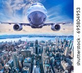 airliner in the sky above new... | Shutterstock . vector #695804953
