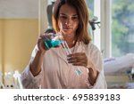 young female laboratory... | Shutterstock . vector #695839183