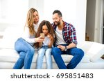 young parents sitting on the...   Shutterstock . vector #695851483