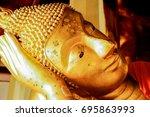 Head Of Golden Reclining Buddh...