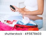 pregnant woman packing for... | Shutterstock . vector #695878603
