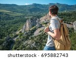 tourist with backpack enjoy... | Shutterstock . vector #695882743