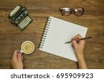 woman hand writing in notebook  ... | Shutterstock . vector #695909923