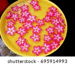 Small photo of Flowers in the basin (adenine)