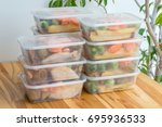 meal prep. stack of home cooked ... | Shutterstock . vector #695936533