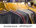 t shirt for the man on hangers... | Shutterstock . vector #695956297