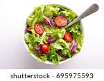fresh salad in a bowl. healthy... | Shutterstock . vector #695975593