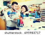 young couple of customers... | Shutterstock . vector #695983717