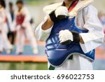 taekwondo kids athletes. moment ... | Shutterstock . vector #696022753