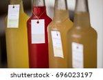 kombucha tea bottle with... | Shutterstock . vector #696023197