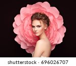 beautiful woman on the... | Shutterstock . vector #696026707