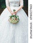 bride in wedding dress with... | Shutterstock . vector #696027463