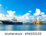 oil rigs under maintenance near ... | Shutterstock . vector #696033133