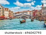 bridge rialto on grand canal... | Shutterstock . vector #696042793