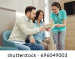 patients consulting the dentist ... | Shutterstock . vector #696049003