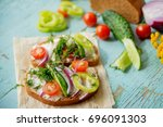sandwich with herb and edible... | Shutterstock . vector #696091303