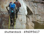 two climbers work on the route... | Shutterstock . vector #696095617