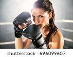 boxer mma female fighter posing ... | Shutterstock . vector #696099607