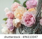 Stock photo english roses in the basket 696113347