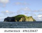 volcanic island. bjarnarey ... | Shutterstock . vector #696120637