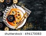 halloween table setting on dark ... | Shutterstock . vector #696170083