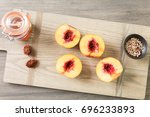 cutting peaches in half for... | Shutterstock . vector #696233893