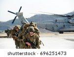 us marine corps soldiers... | Shutterstock . vector #696251473