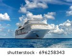 cruise ship in crystal blue... | Shutterstock . vector #696258343