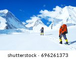 group of climbers reaches the... | Shutterstock . vector #696261373