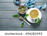 composition with herbal tea on... | Shutterstock . vector #696282493