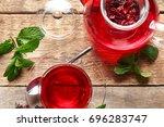 composition with hibiscus tea... | Shutterstock . vector #696283747
