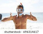guy in beach in scuba mask and...