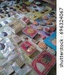 Small photo of Blurred photo of a lot amount of Buddhist amulets