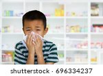 asian kid with the tissue  blur ... | Shutterstock . vector #696334237
