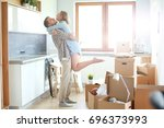 portrait of young couple moving ... | Shutterstock . vector #696373993