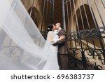 wedding couple walking in the... | Shutterstock . vector #696383737