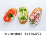 mini sandwiches with cream... | Shutterstock . vector #696403933