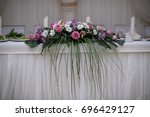 table for brides with flowers | Shutterstock . vector #696429127