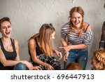 group of four friends laughing... | Shutterstock . vector #696447913
