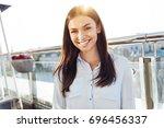 happy brunette woman smiling   Shutterstock . vector #696456337